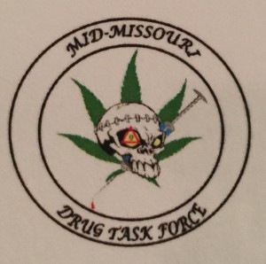 The Mid-Missouri Drug Task Force even tries to keep its logo secret. Viewing it, one wonders why.