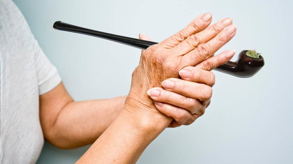senior hands arthritis pipe cannabis herb